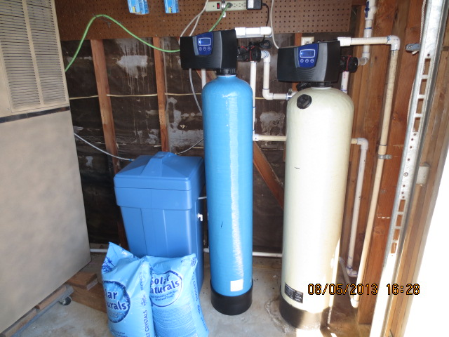 Calcite neutralizer neutralizes acid water pH. Softener removes hardness minerals for clean water throughout the home.
