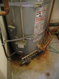 Corroded Water Heater Leaking On Floor