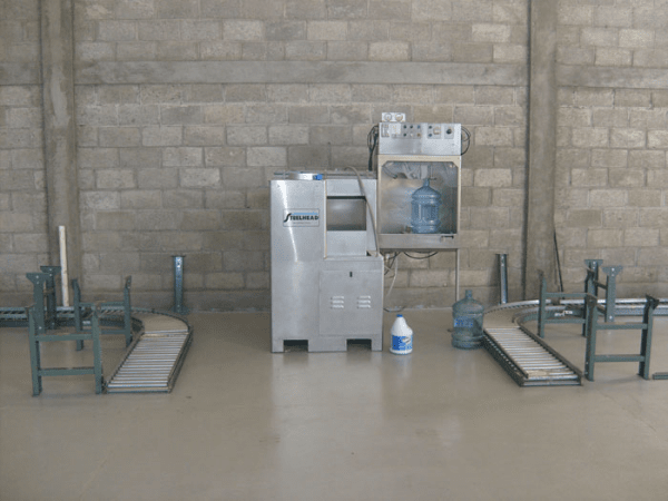 Water bottling washing machine with ozone